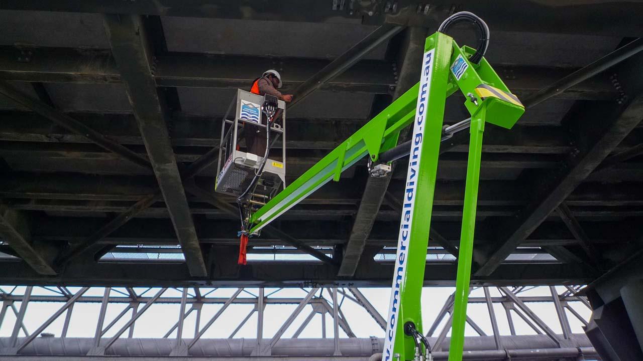 Boat Elevated Work Platform Under Bridge