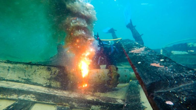 Commercial Diver Underwater Cutting