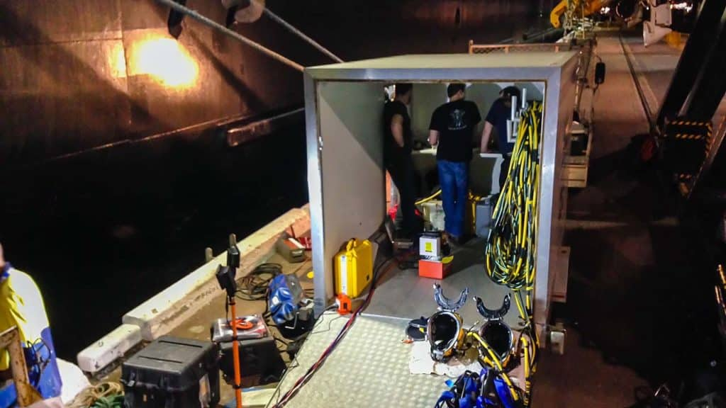 Commercial Divers Preparing For Night Dive