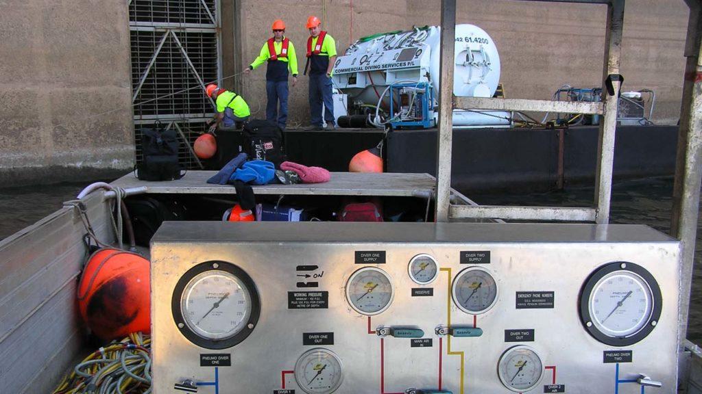 Dam Crew On Barge